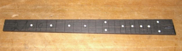 Fretboard with dot markers