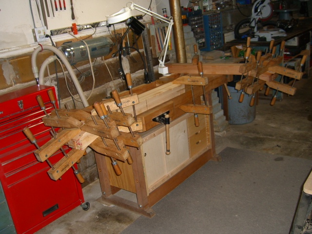 Headstock veneer clamped on - both